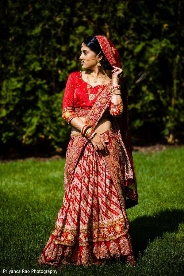 Maharani wearing a red lengha posing for picture.