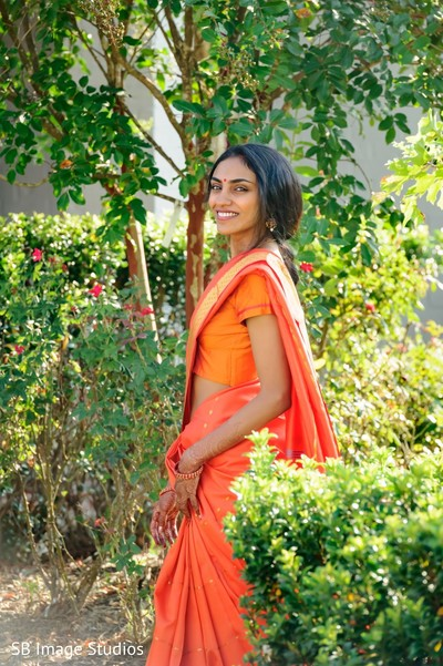 Maharani in an orange anarkali on the venue's yard