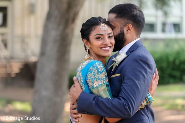 Maharani smiling while hugging her Indian groom.