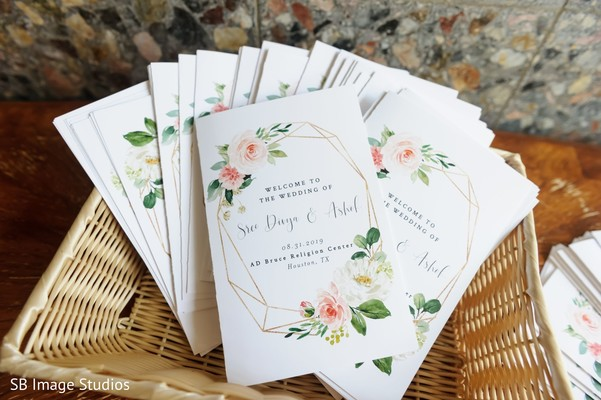 White with flowers Indian wedding invitations.