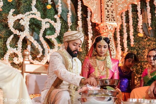 Indian couple during hindu wedding rituals.