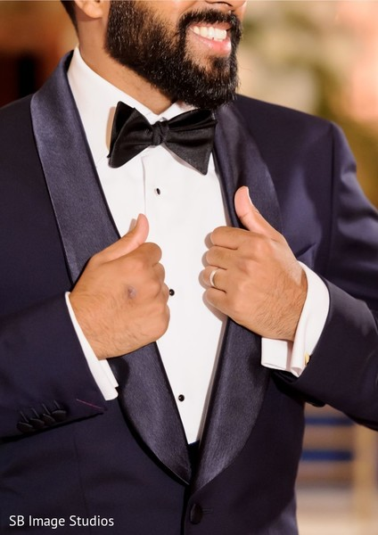 Indian groom wearing a blue suit.