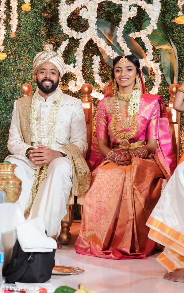 Indian couple  seat at ceremony mandap.
