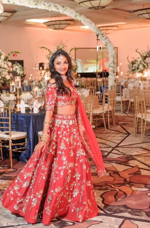 Indian bride on her red and golden reception outfit.