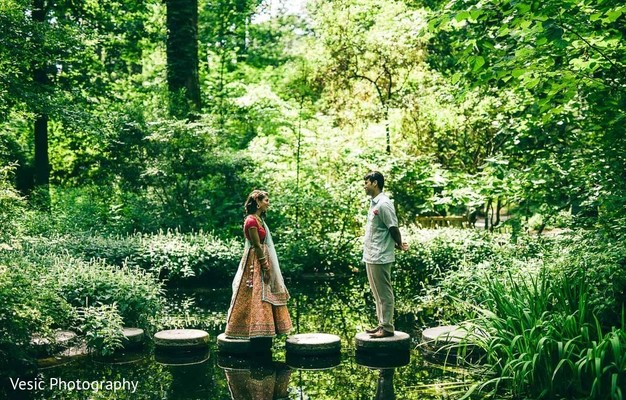 Indian couple staring at each other at the forest beck