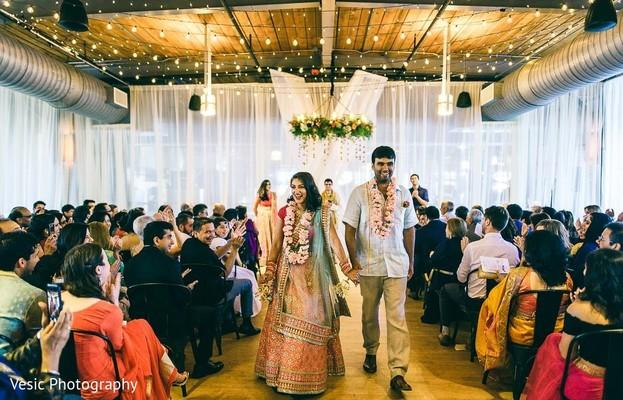 Indian newlyweds walking down the aisle