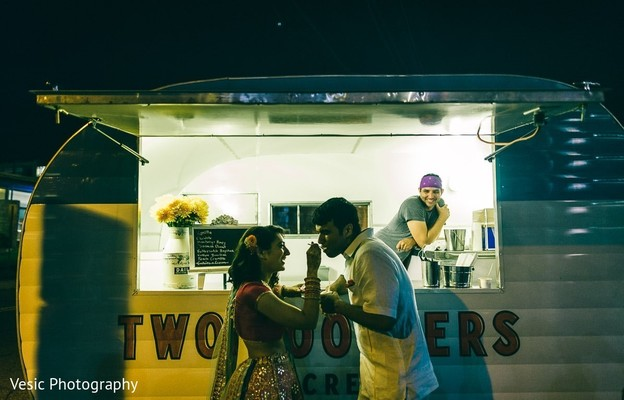 Indian bride feeding her Indian groom