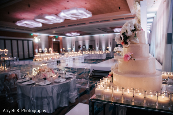 Indian wedding cake and table decoration for reception.