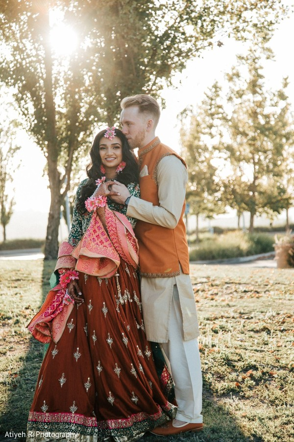 Maharani with green and brown saree and her Indian groom.