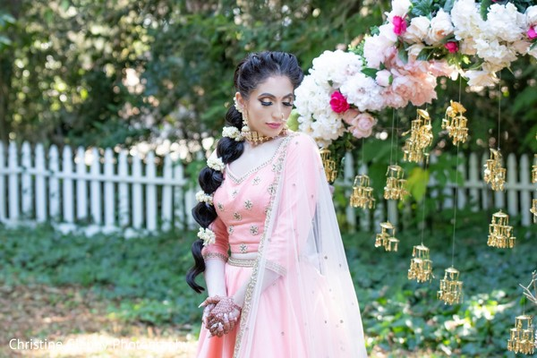Maharani wearing the baby pink saree during the photo session.