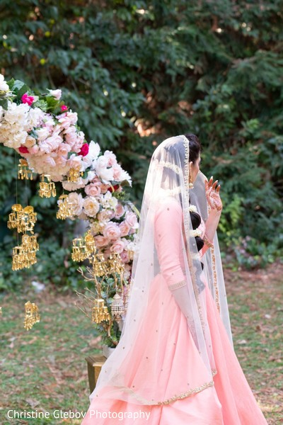 Indian bride's baby pink saree design photography.