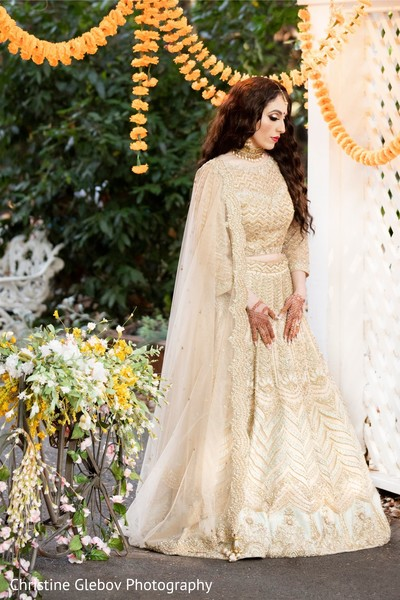 Indian bride posing with reception gown lengha.