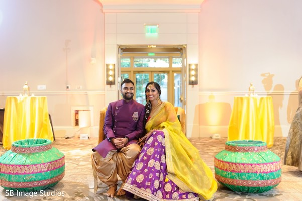 Indian couple posing at their Sangeet stage.