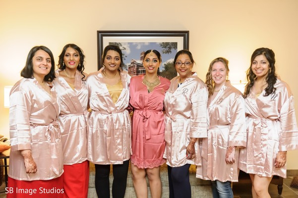 Maharani and bridesmaids on their silk pink robe.