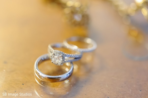 Indian bride and groom's white gold and diamonds wedding rings.
