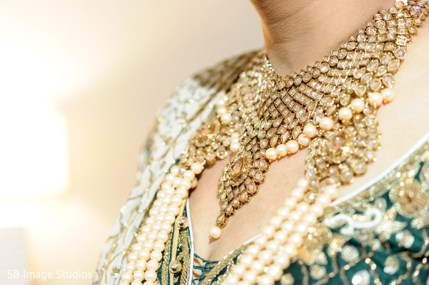 Golden with diamonds and pearls Kundan necklace.