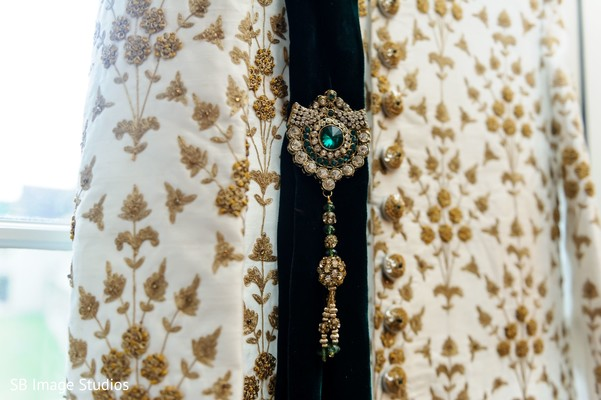 Indian groom's Dupatta with green jewelry.