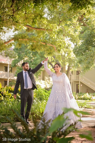 See this gorgeous indian couple posing outdoors.