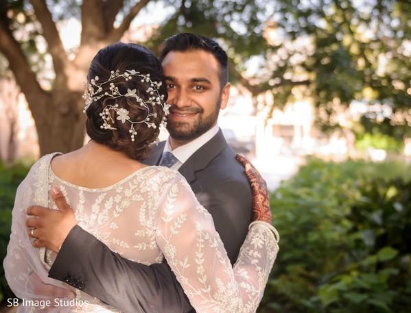 Indian groom hugging bride.