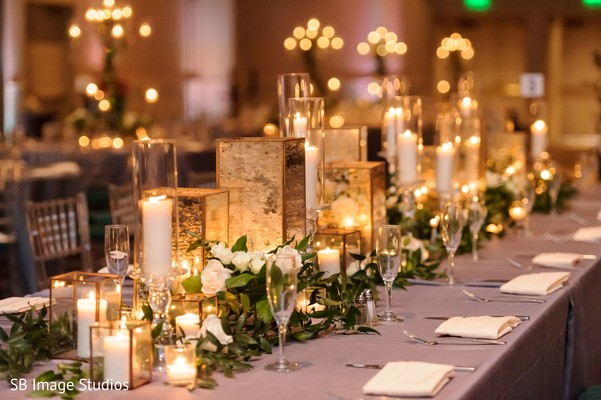 Incredible Indian wedding rectangle table centerpiece decor.