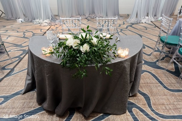 Indian couple's reception table flowers decoration.