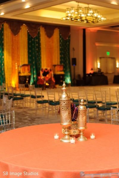 Sangeet table golden lanterns decorations.