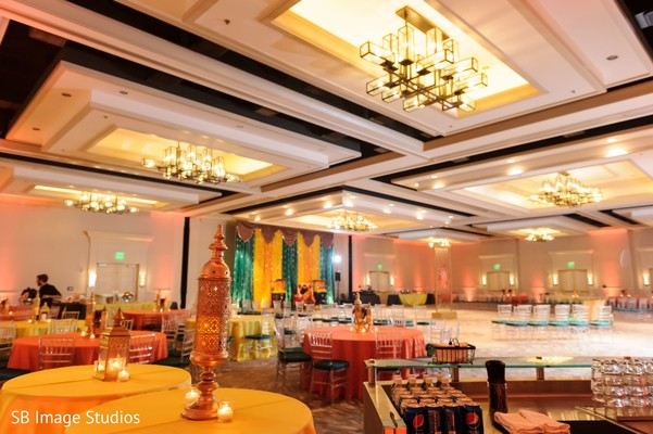 Yellow, orange and green colors for sangeet decoration.