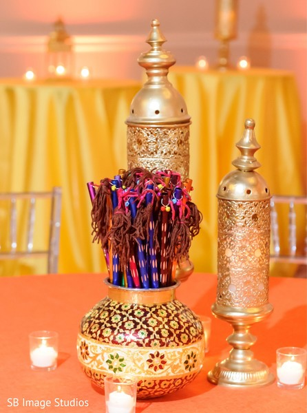 Golden Sangeet table lanterns and  pot decoration.