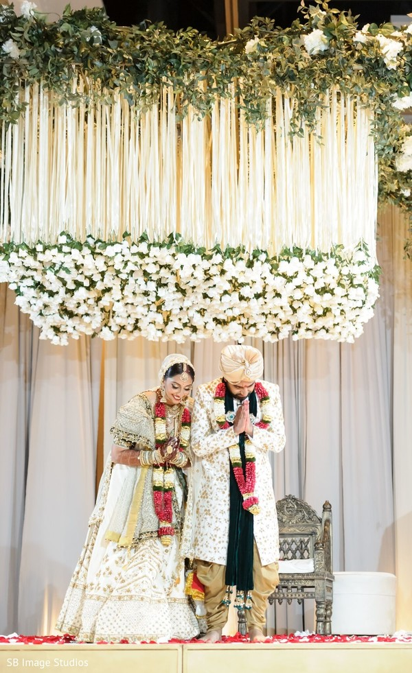 Indian couple at wedding ceremony stage capture.