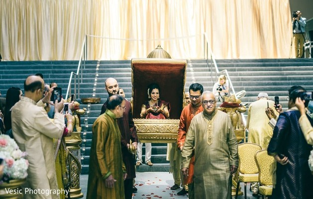 Maharani being carried down the aisle