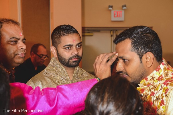 Raja receiving the bindi as guests observe.
