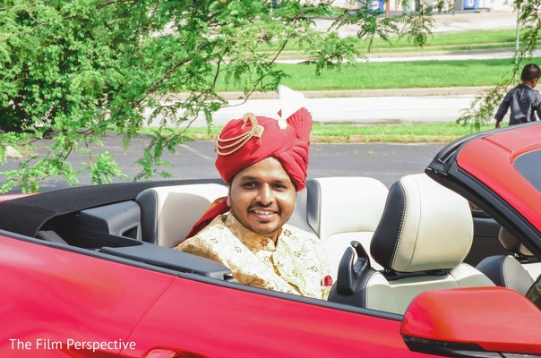 Raja riding his car to the ceremony.