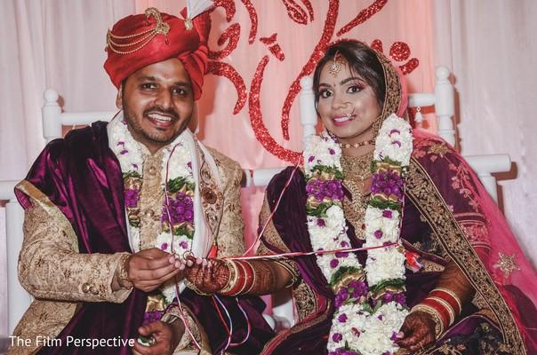 Maharani and Raja wearing the traditional saree and sherwani.