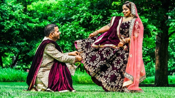Indian bride and groom outdoors during pictures.
