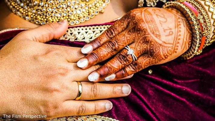 Indian bride's mehndi design and bridal ring.