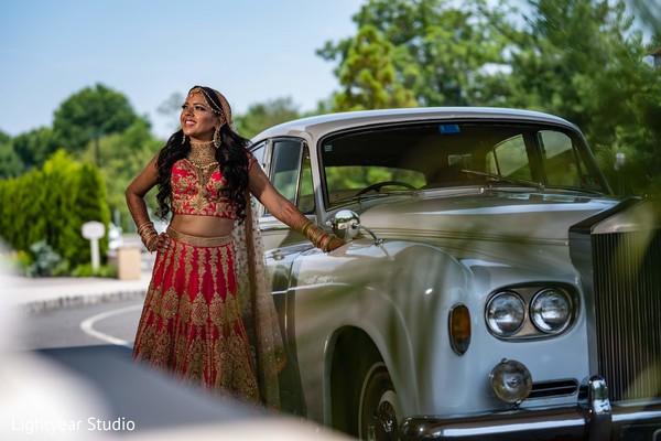 Maharani posing next to her white rolls royce.
