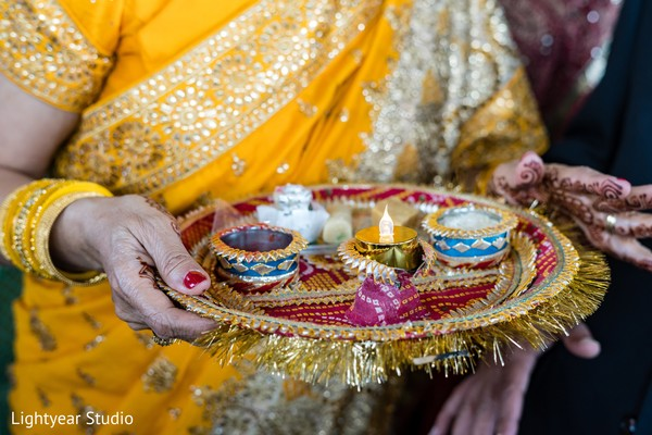 Indian relative holding the sacred items.