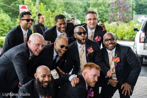 Indian groom posing with groomsmen capture.