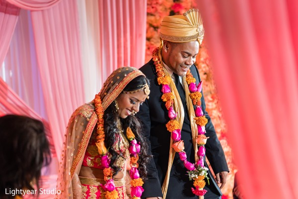 Indian couple with their ceremony ritual garlands.