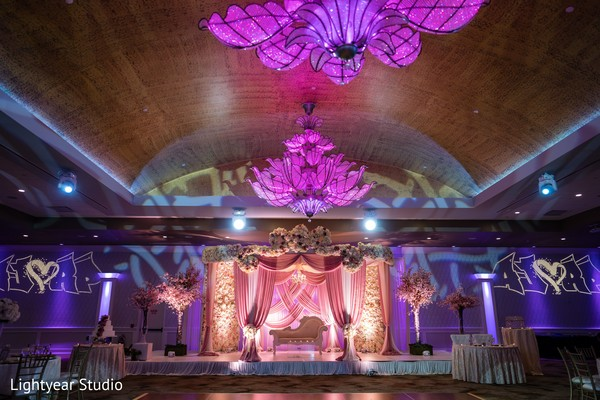 Purple, pink and white Indian wedding reception decoration.