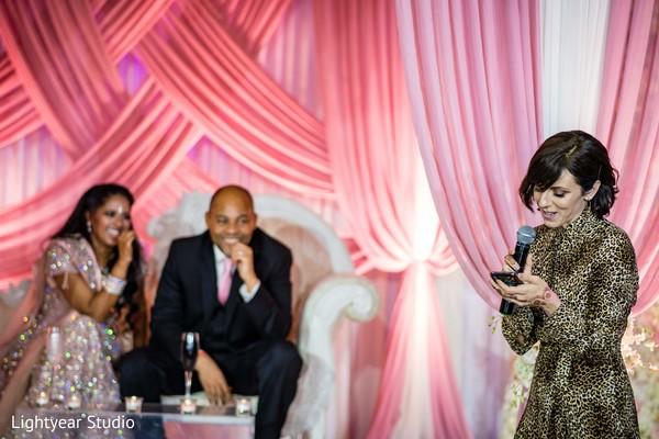 Indian wedding guest during reception speech.
