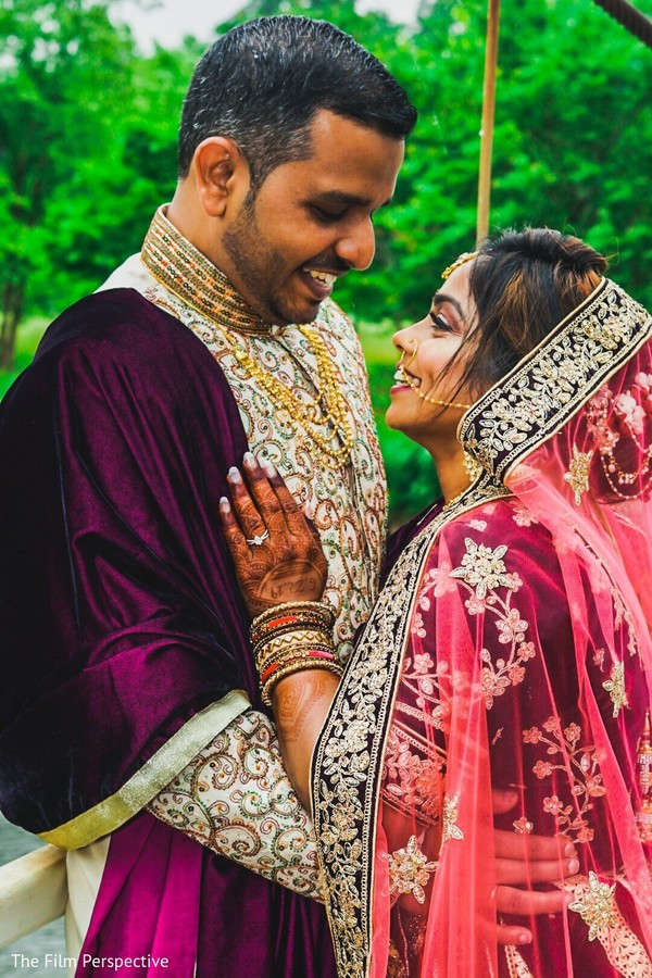 Indian couple posing for pictures.