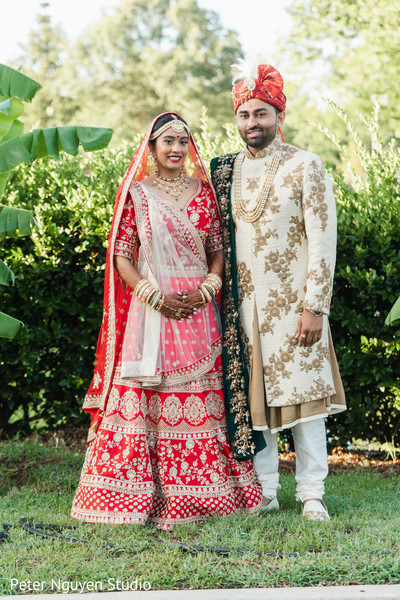 Indian bride and her Indian groom posing on the yard