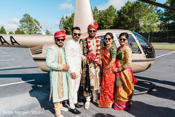 Indian groom and Indian relatives posing in front of the chopper