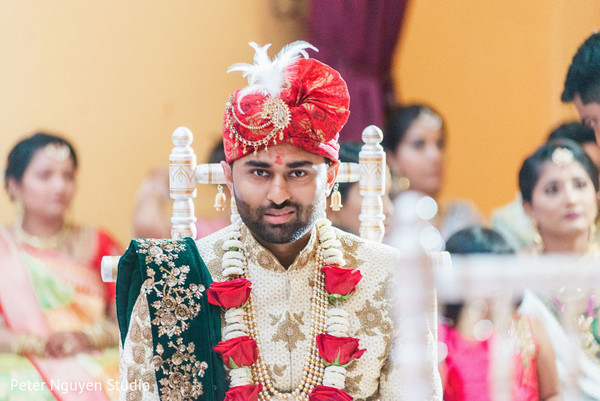 Indian groom sitting on stage