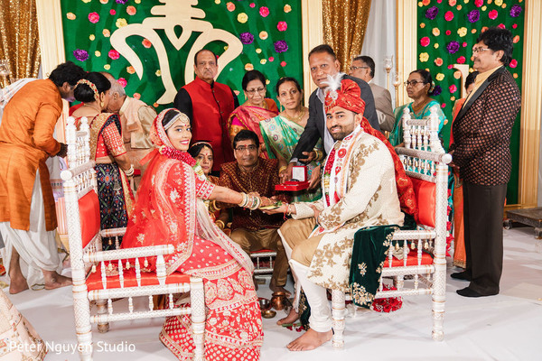 Indian couple looking at the camera for wedding picture.