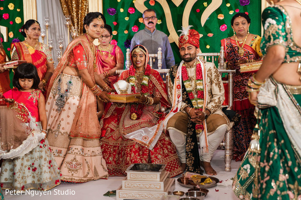 Indian couple and guest in hindu wedding picture.