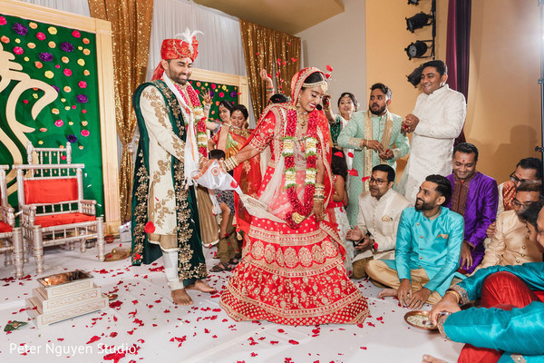 Maharani walking on the wedding altar with her groom.