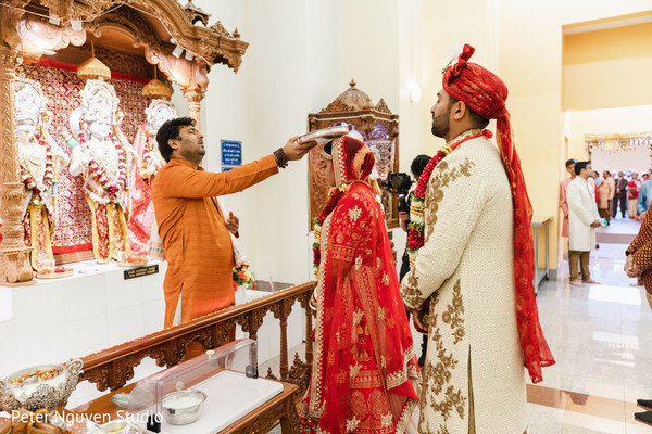 Maharani and her Indian groom receiving the blessings.