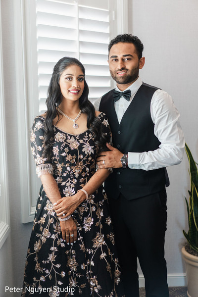 Indian couple getting ready for the reception at the venue.